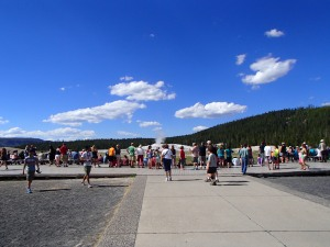 Masses of people sit and wait the approximate 90 minutes waiting to see Old Faithful